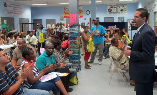 Councilman Cabrera addresses homeowners at UNHP's resource fair on July 13.