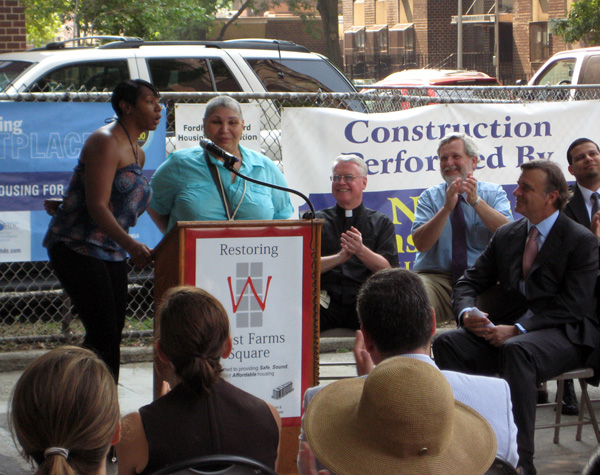 West Farms tenants, Anita Walker and Yvonne Adorno, get a round of applause from the officials and developers of the project at the July 20th press conference.