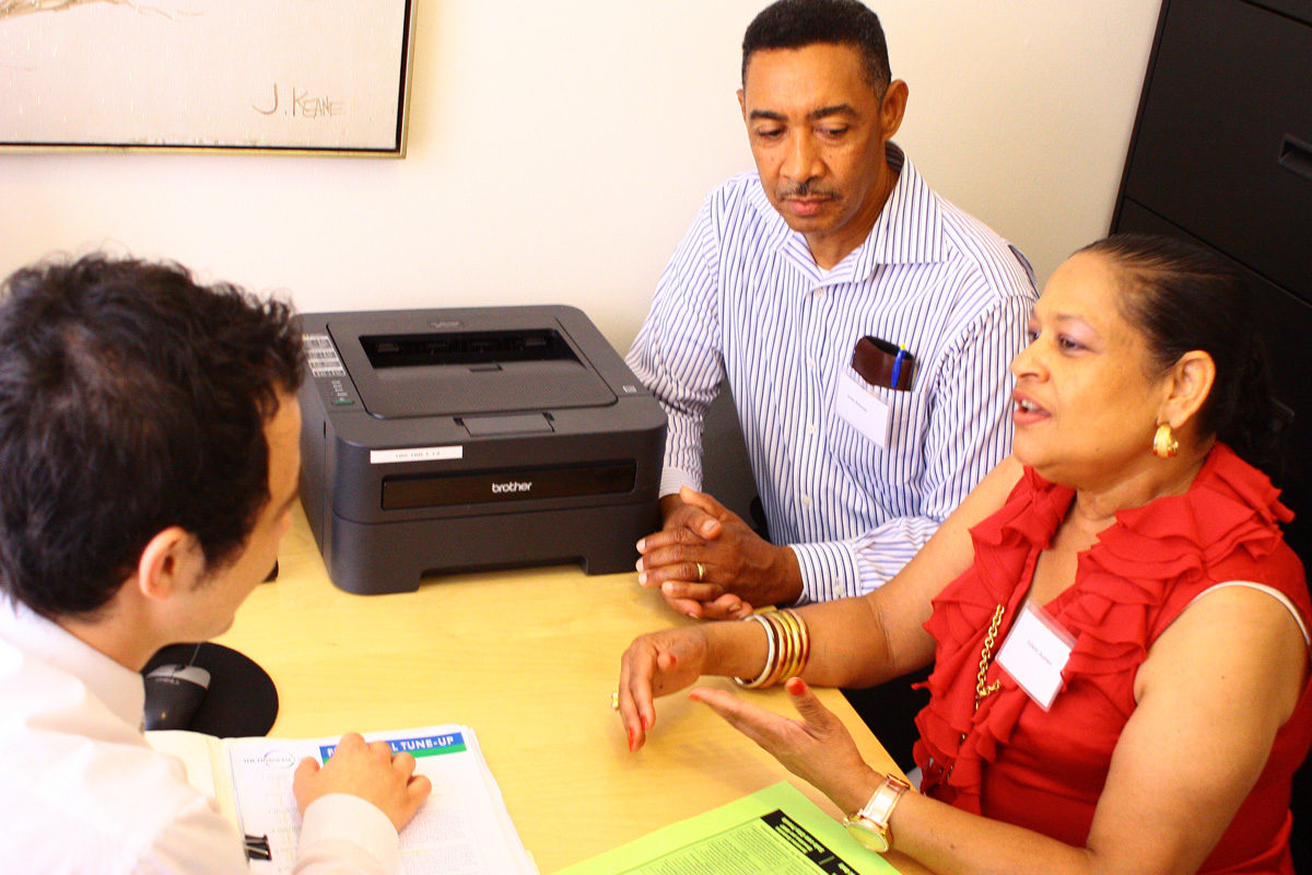 Clients meet with a financial coach at the Northwest Bronx Resource Center.