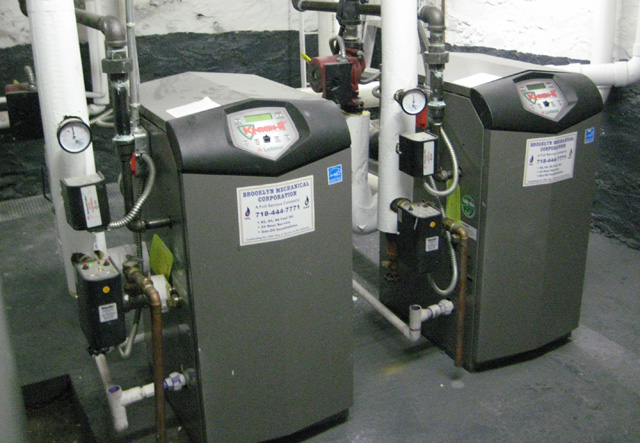 New gas fired high efficiency steam and hot water boilers are installed at 2242 Valentine Ave.