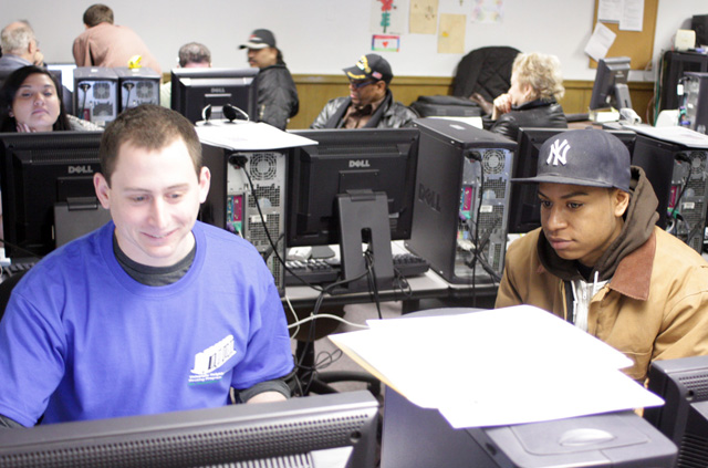 Local residents get free tax preparation assistance from UNHP staff and volunteers including many college students.
