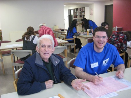 """Frank is """"content"""" Rose Hill Apartments for low-income senior citizens, but is surprised he is still here. Pictured above, Frank shares a laugh with UNHP intake worker, Joe."""
