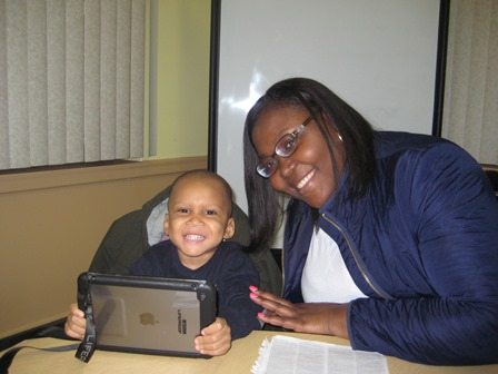 2 year old Darias, pictured here with his iPad and his mother, Sheryell.