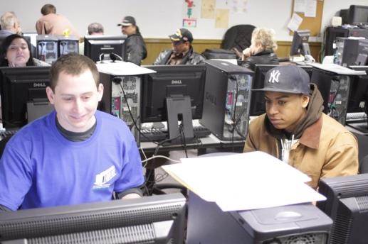 Josh filing taxes during UNHP Free Tax Preparation Program