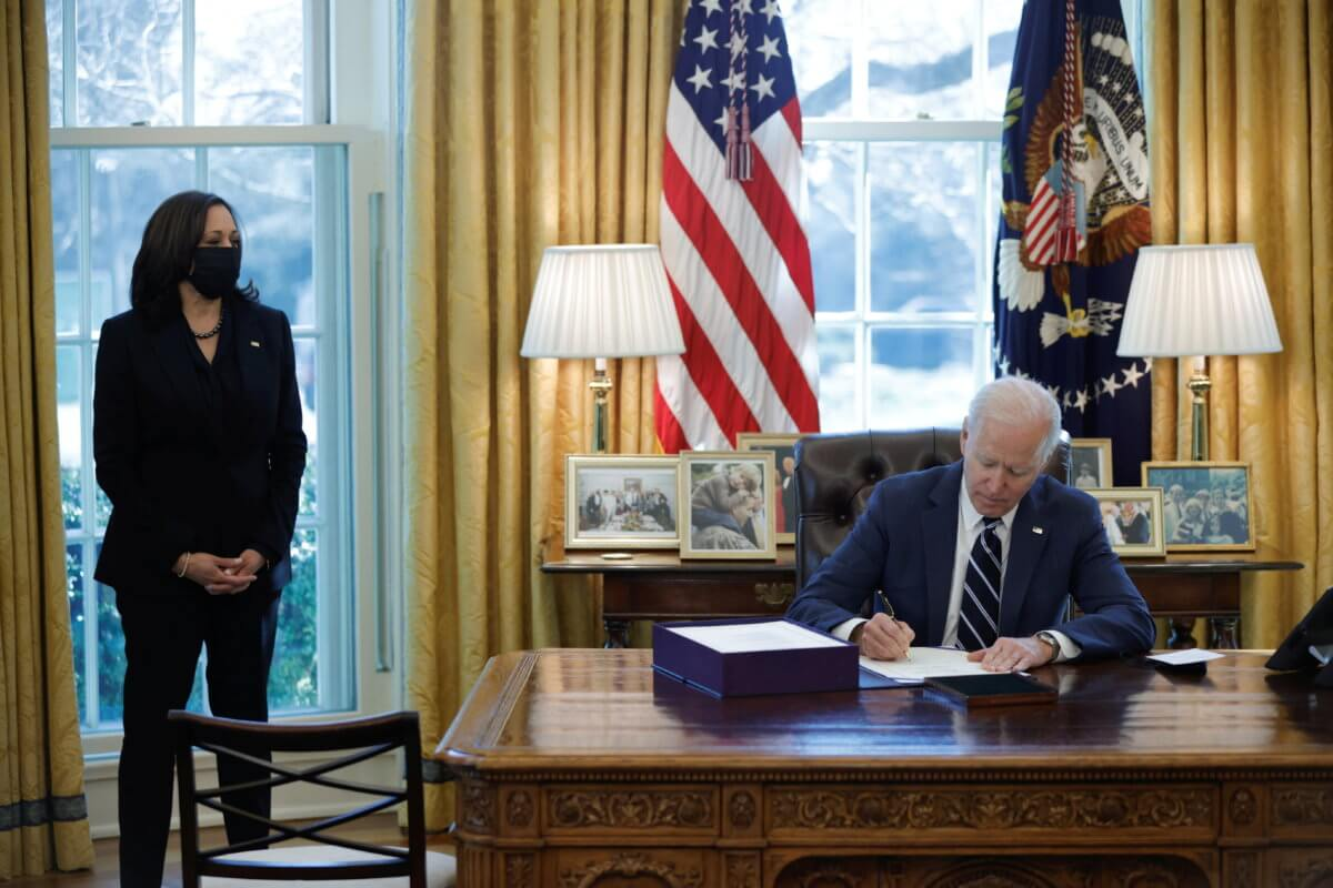 President Biden signing the American Rescue Plan on March 11