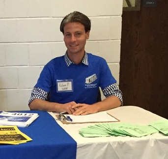 IPED Fellow Adam Pearlman mans the student volunteer booth at Lehman College.