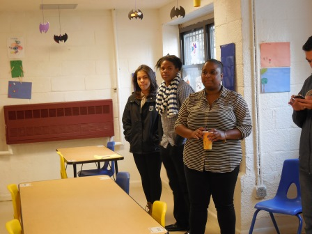 Norsy Jimenez and after-school program staff in the community room at West Farms Square.