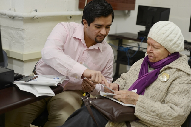 Brian Bier, the financial coach at the Northwest Bronx Resource Center, helping one of our West Farms clients.