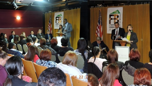 "Gregg Bishop ( left), Deputy Commissioner for NYC Small Business Services, was thrilled that the Northwest Bronx Childcare Entrepreneurship Program allowed SBS to serve women entrepreneurs – a priority that's represented by their recent WE NYC initiative, which expands the economic potential of women entrepreneurs across the five boroughs. 24 of the 25 graduates were women and two-thirds of the class was Spanish speakers. Colleen Galvin, (right) Senior VP for Citi Community Development congratulates the graduates with Spanish translation from FBCS Executive Director, John Garcia. She also thanked the partner organizations and ""most importantly, the family and friends who provide support and encouragement"" to the childcare providers."